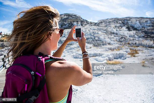 Woman with smartphone in Yellowstone National Park