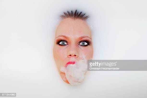 Woman with smoke out of mouth