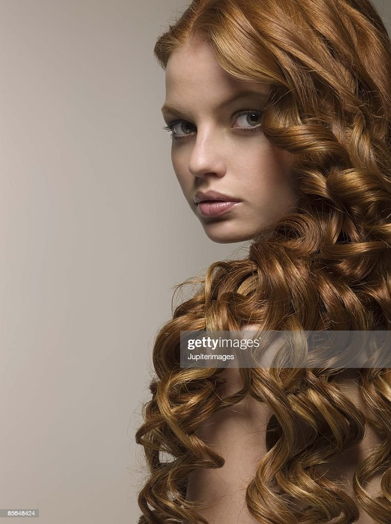 Woman with smooth curls of hair : Stock Photo