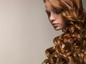 Woman with smooth curls of hair