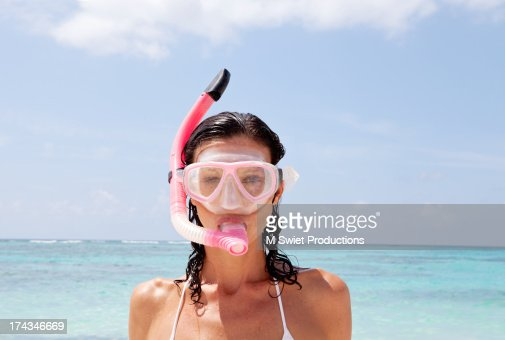 Woman with snorkel and mask