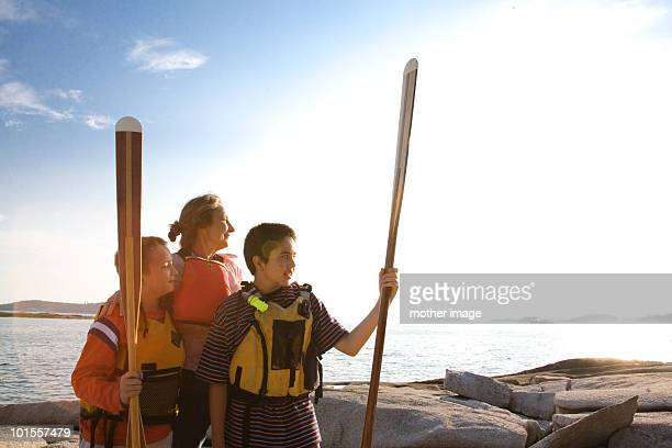 Woman with sons getting ready to kayak