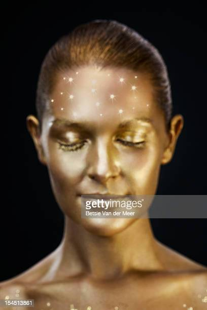 woman with  sparkles twinkling on forehead.
