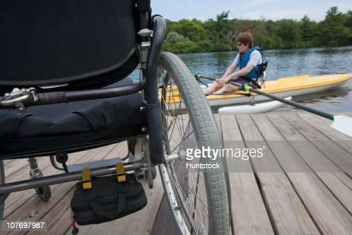 Woman with spinal cord injury preparing for a boat race