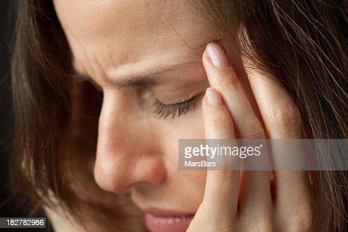 Woman with splitting headache