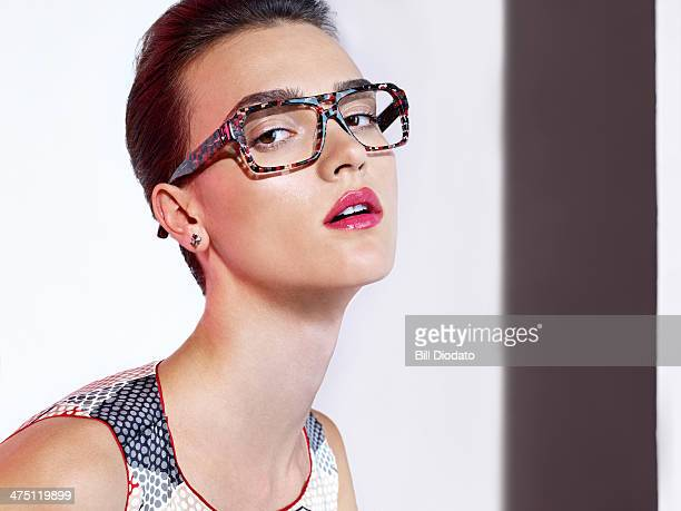 Woman with squared glasses in studio