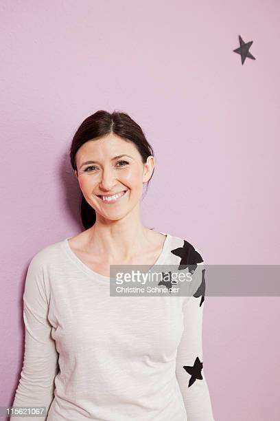 Woman with stars smiling
