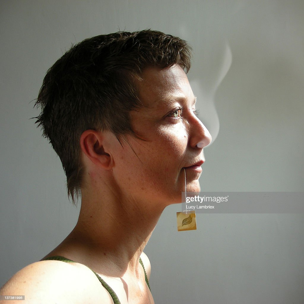 Woman with steaming nose : Stock Photo