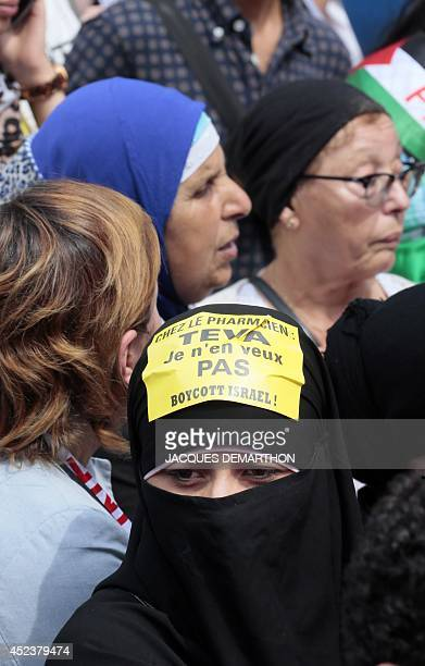 A woman with sticker on her niqab reading 'At the pharmacists TEVA I don't want it Boycott Israel' as she gathers with others near the...