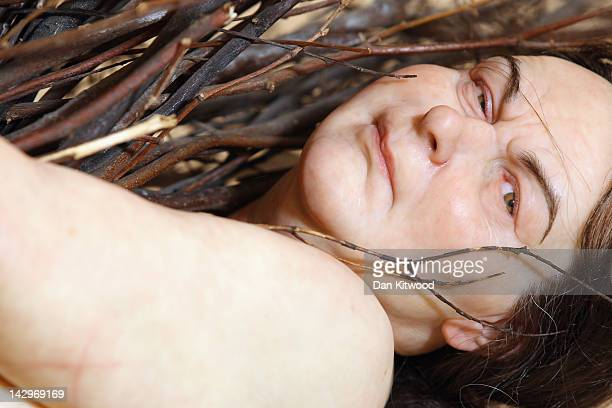 'Woman with Sticks' by artist Ron Mueck is moved into its final position at the Hauser Wirth gallery on April 16 2012 in London England The piece...