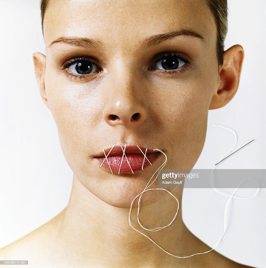 Woman with stitches over mouth, portrait : Stock Photo