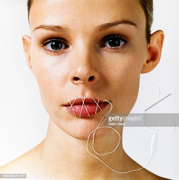 Woman with stitches over mouth, portrait