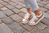 Woman with stylish shoes in the city