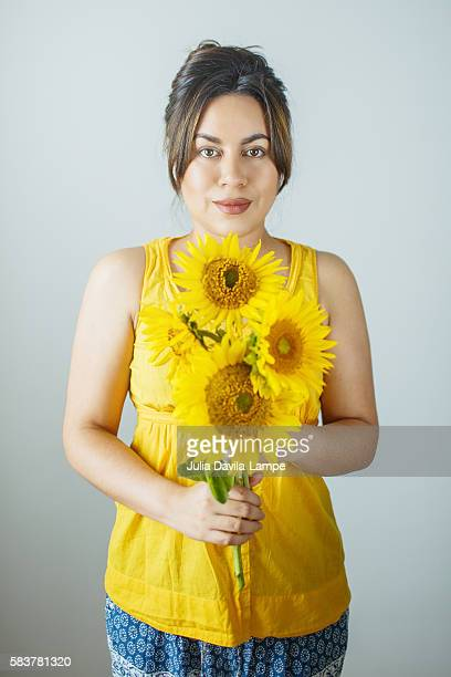 Woman with sunflowers.
