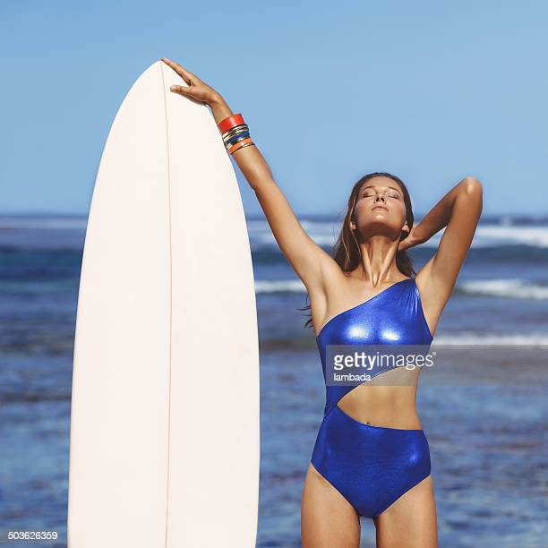 Woman with surf board