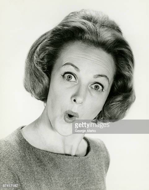 Woman with surprised expression, posing in studio, (B&W), (Portrait)