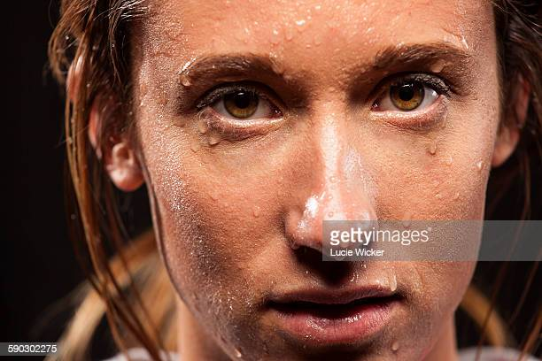 Woman with sweat on face