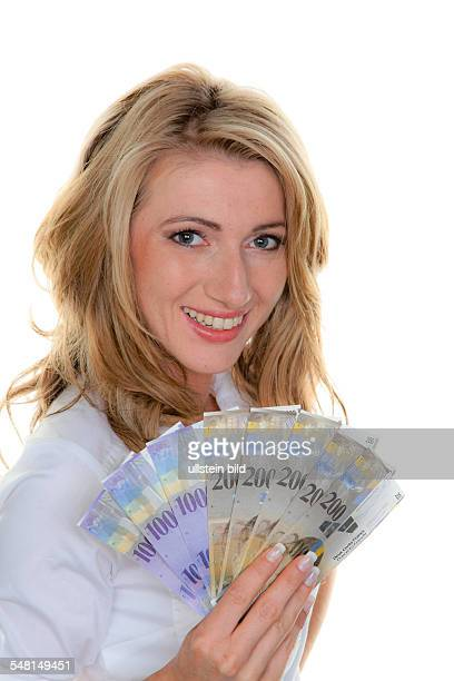 woman with Swiss Francs banknotes