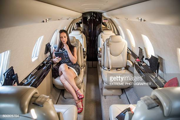 Woman with tablet in private airplane