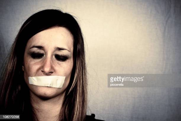 Woman with Tape Covering Mouth
