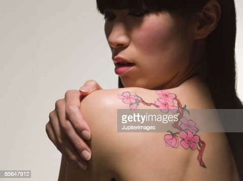 Woman with tattoo : Stock Photo