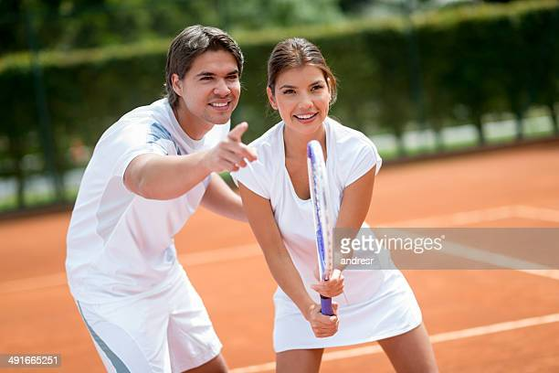 Woman with tennis trainer