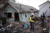 A woman with the Army Corps of Engineers and a representative from FEMA document a destroyed home November 28 2012 in a residential area of New Dorp...