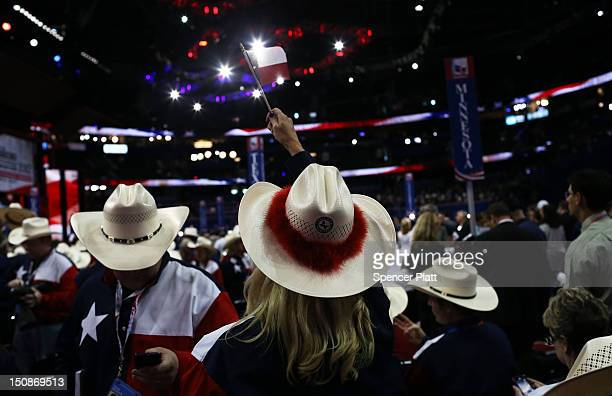 A woman with the Texas delegation waves a Texan flag during the Republican National Convention at the Tampa Bay Times Forum on August 28 2012 in...