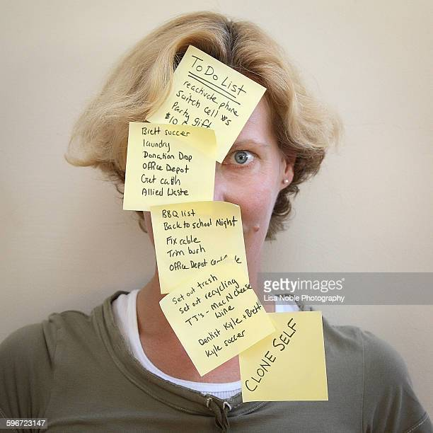 Woman with to do list notes on her face
