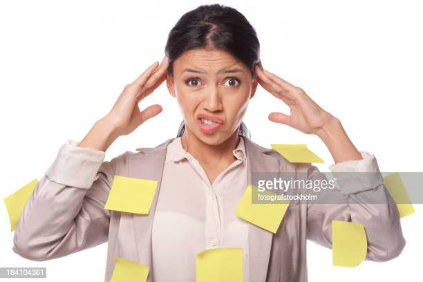 Woman with too much to do covered with many Post It notes