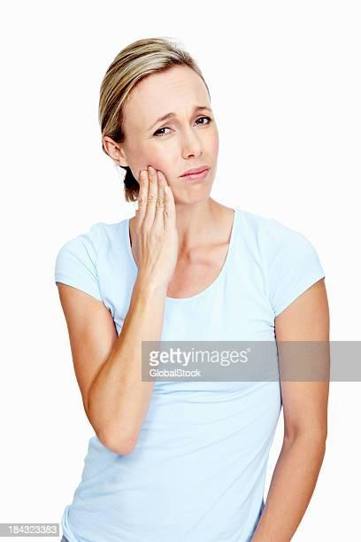 Frau mit Zahn Schmerzen
