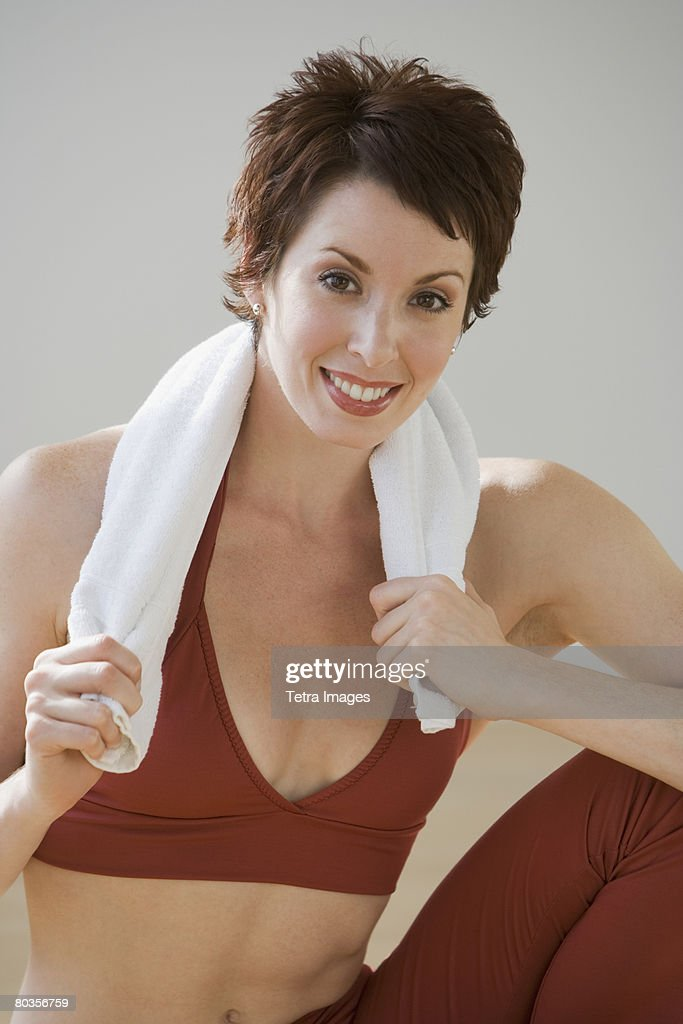 Woman with towel around neck