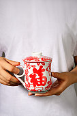 Woman with traditional Chinese tea mug