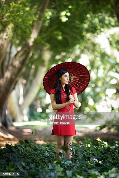 woman with traditional umbrella