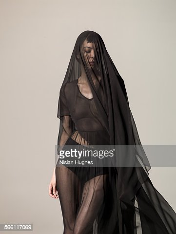 Woman with translucent silk over her