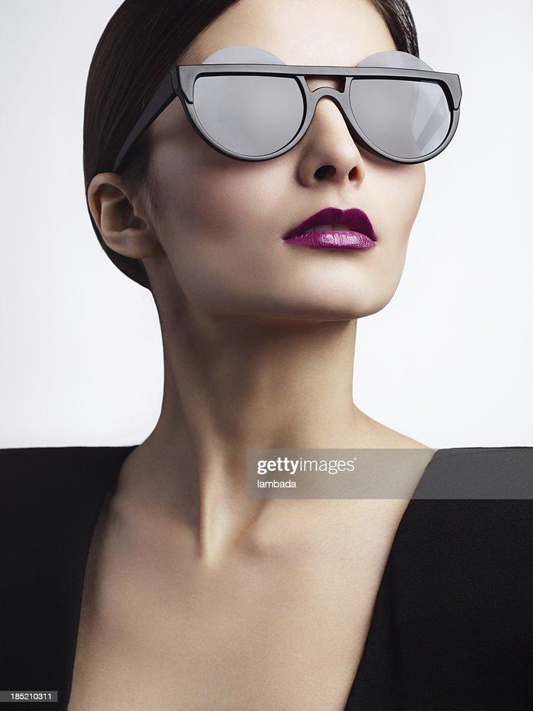 trendy optical glasses  Woman With Trendy Eyewear Stock Photo