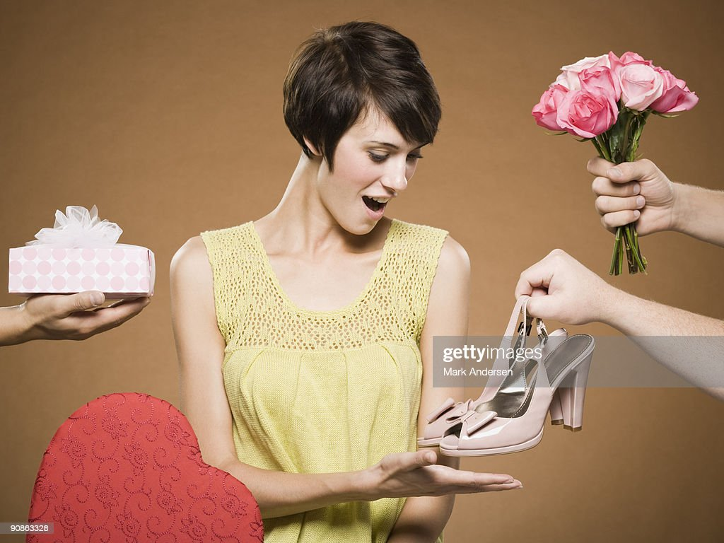 Woman with two men giving presents : Stock Photo