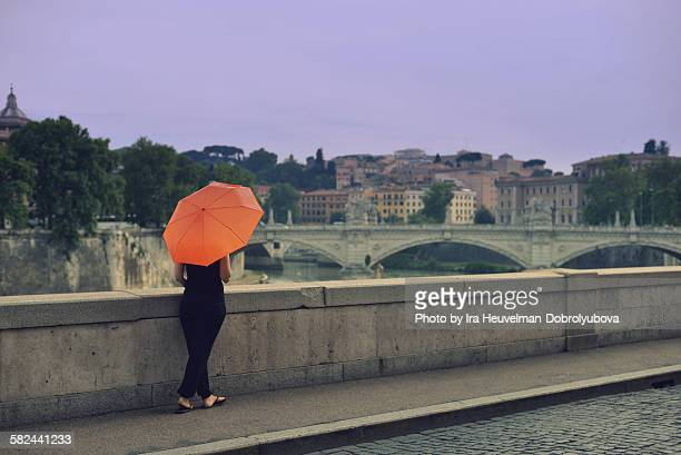 Woman with umbrella in autumn Rome