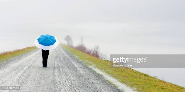 XL woman with umbrella