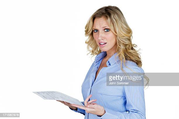 Woman with unhappy look pointing to a document