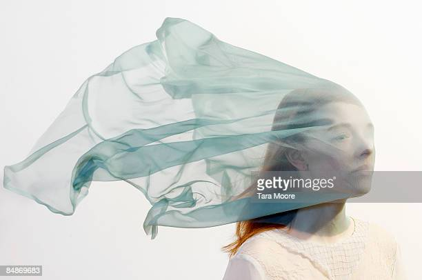 woman with veil blowing over face