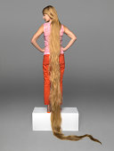 Woman with very long hair in studio