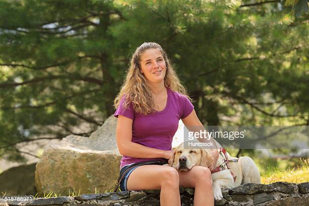 Woman with visual impairment relaxing with her service dog