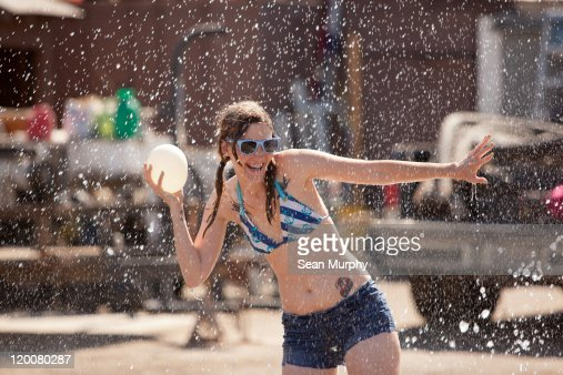 Woman with water balloon and water droplets