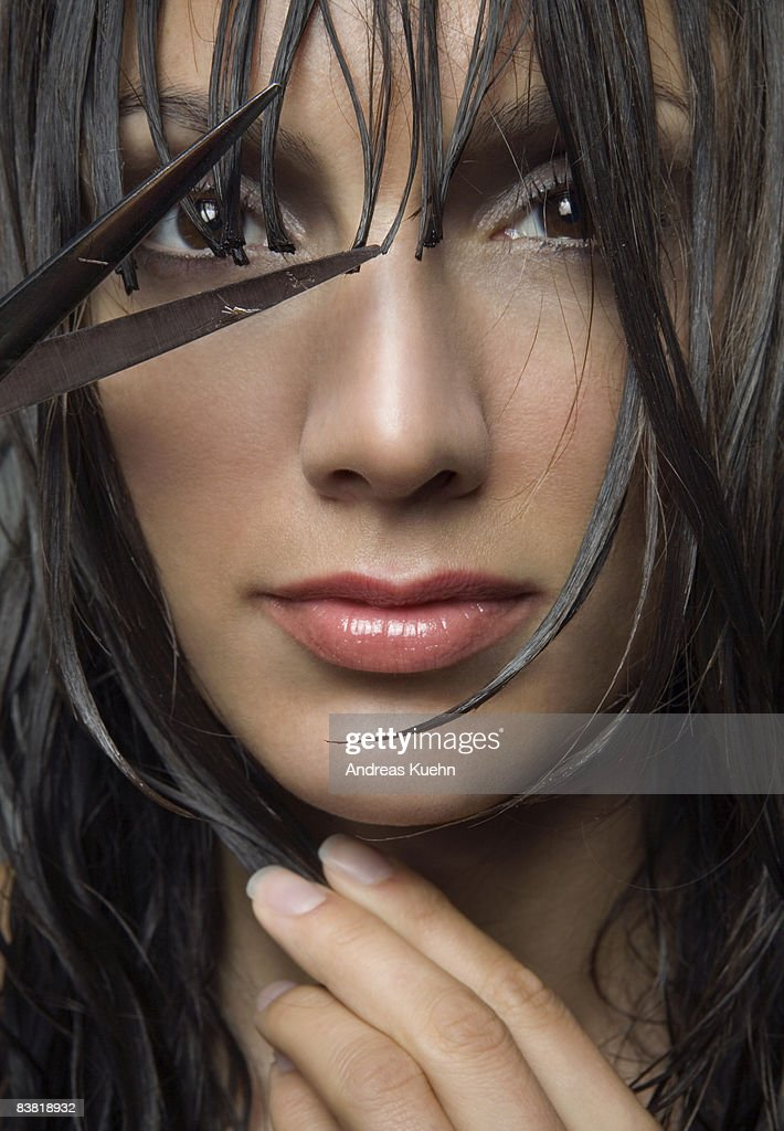 Woman with wet hair and scissors, portrait. : Stock Photo