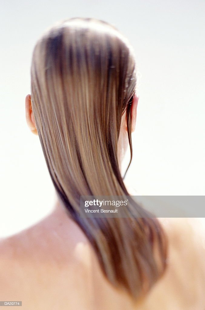Woman with wet hair, close-up, rear view : Stock Photo