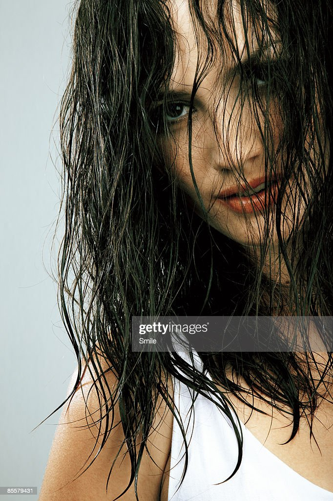 Woman with wet hair covering face : Stock Photo