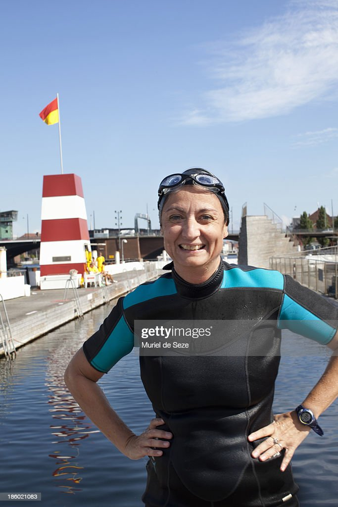 Woman with wetsuit, smiling. : Stock Photo