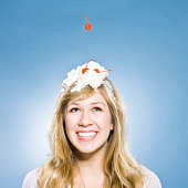 woman with whipped cream and a cherry on her head