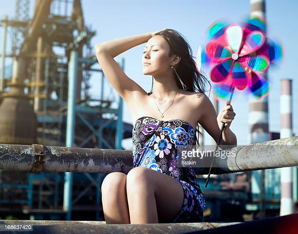 Woman with whirligig at the factory